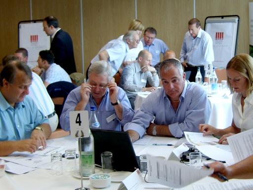 Teams at tables during a simulation event
